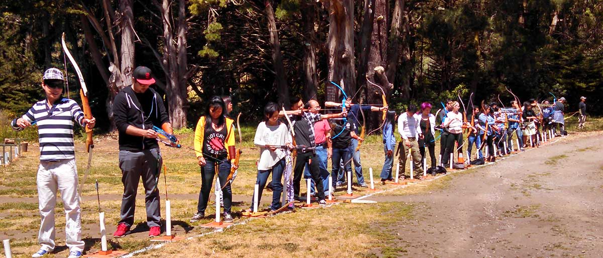 Archers get ready to shoot from the line on a sunny day at San Francisco Archers.